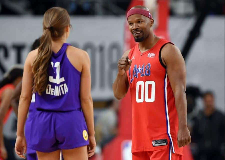 Photo of Jamie Foxx talking to Rachel DeMita during the NBA All-Star celebrity basketball game in LA.