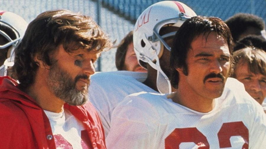 Photograph of Burt Reynolds and Kris Kristofferson in the movie 'Semi-Tough.'