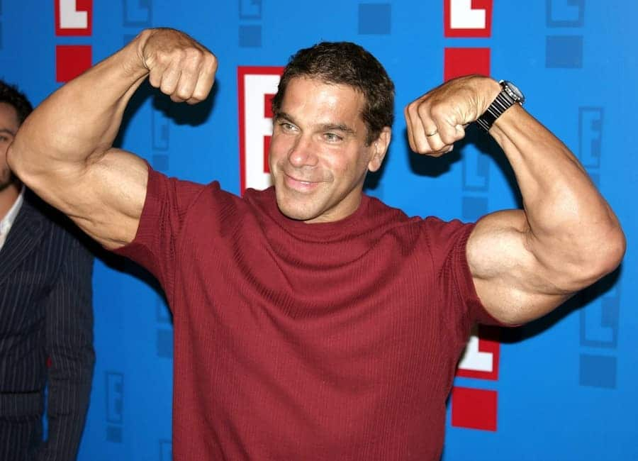 Lou Ferringo flexing his muscles at E! Entertainment Television's summer splash event in 2005.