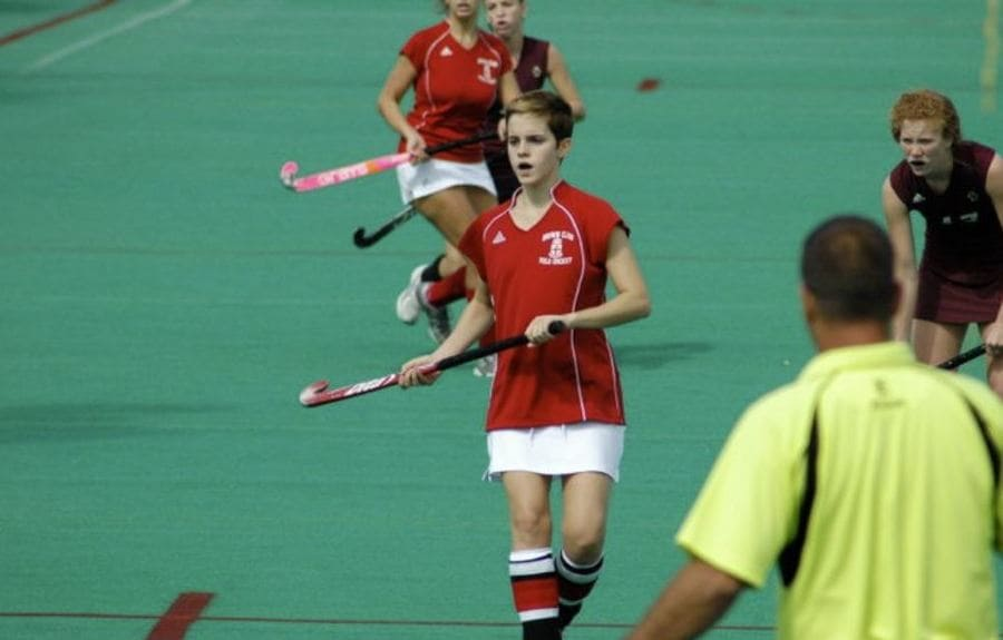 Photograph of Emma Watson playing field hockey in college.