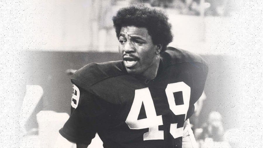 Photograph of Carl Weathers, number 49, playing for the Oakland Raiders.