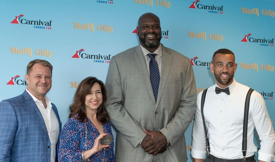 Shaq standing with Matt Mitcham, Christine Duffy, and Eddie Allen, showing you how tall he really is.