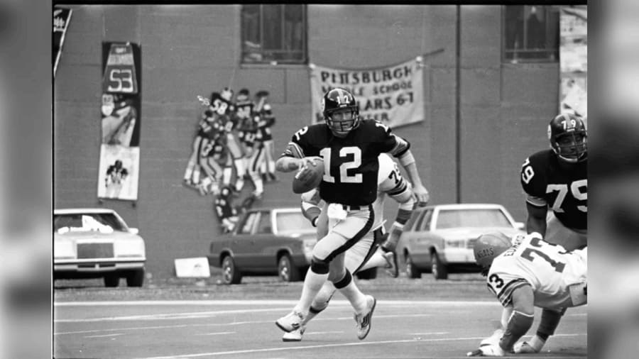 Terry Bradshaw, number 12, running with the football building up his career passing yards.