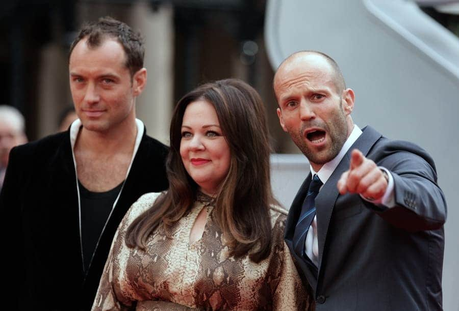 Jason Statham, pictured right, standing with Jude Law and Melissa McCarthy at a premiere in London.