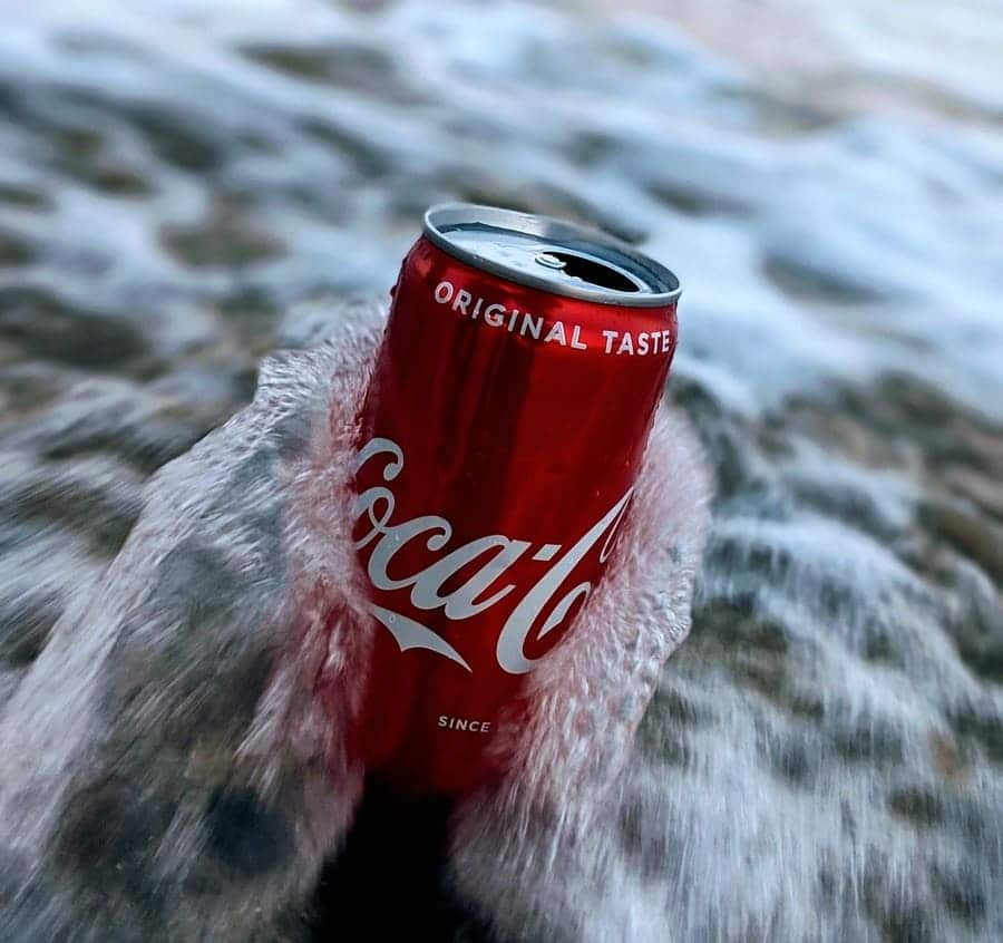 A Coca Cola can on the beach