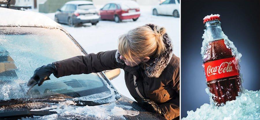 Women cleaning frozen car window/bottle of Coca Cola