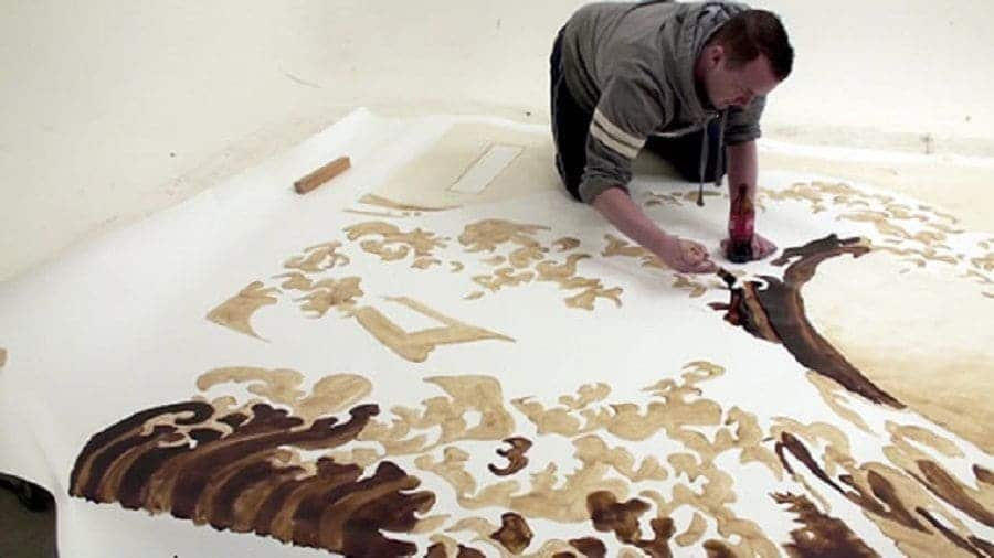 Phil Hansen painting with Coca Cola