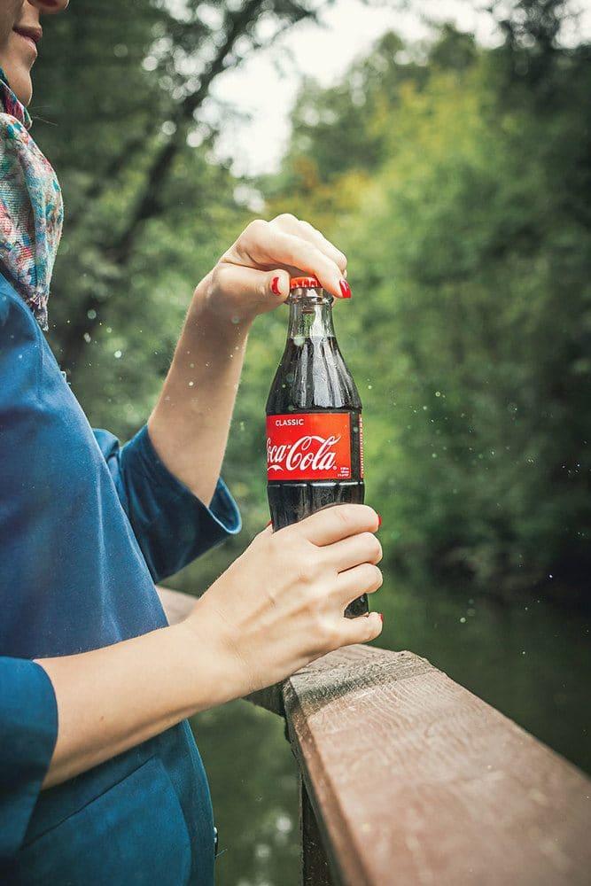 Women holding a Coke bottle