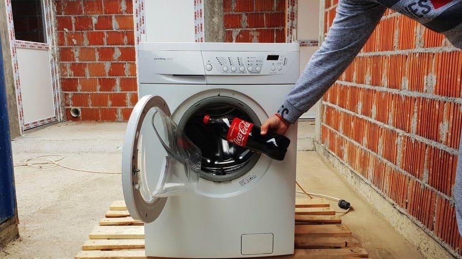 A Coke bottle in a washing machine