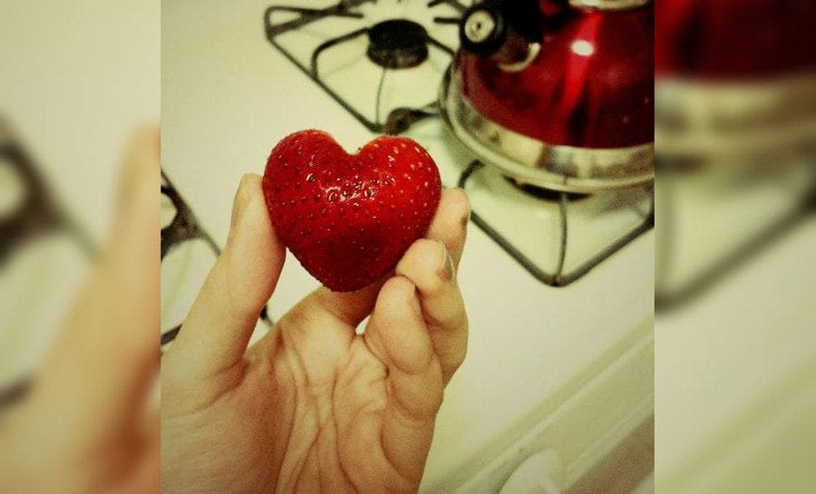A strawberry shaped like a perfect heart