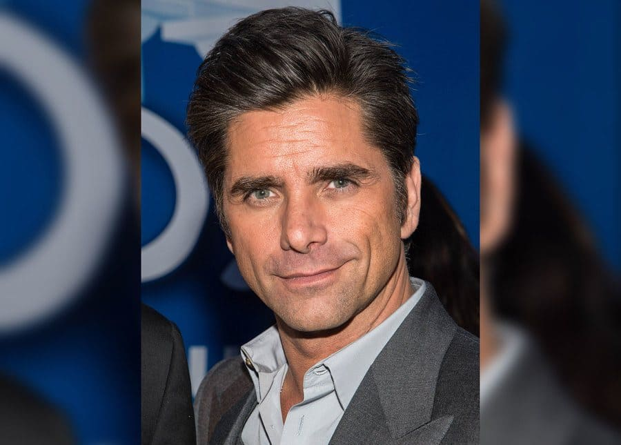 Actor John Stamos visits the Dannon Oikos Tent on Park Avenue