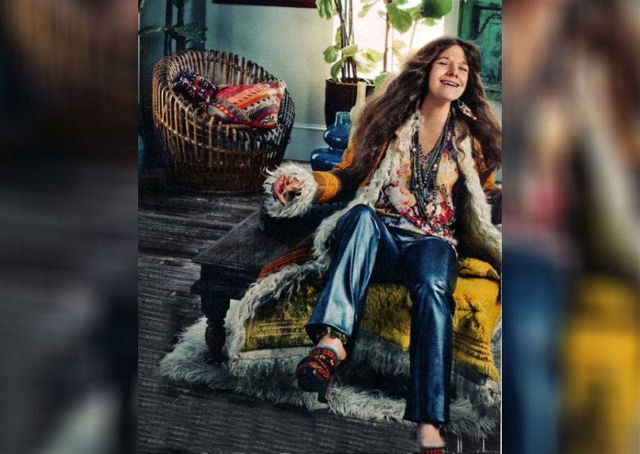 Janis Joplin with her infamous coat and blue jeans.