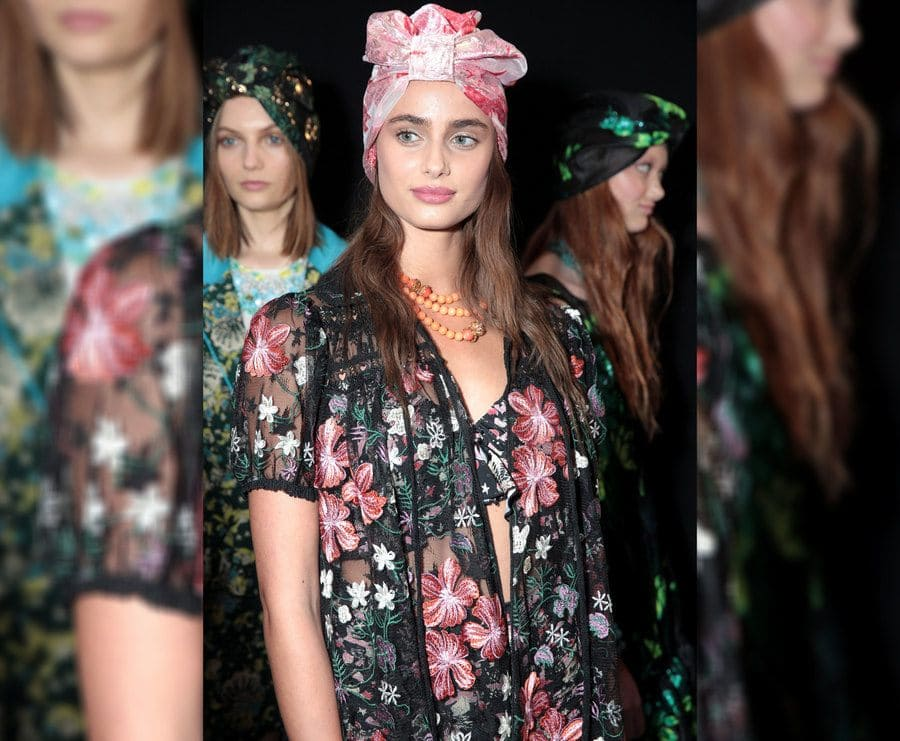 Taylor Hill backstage with her full look on at the Anna Sui show.