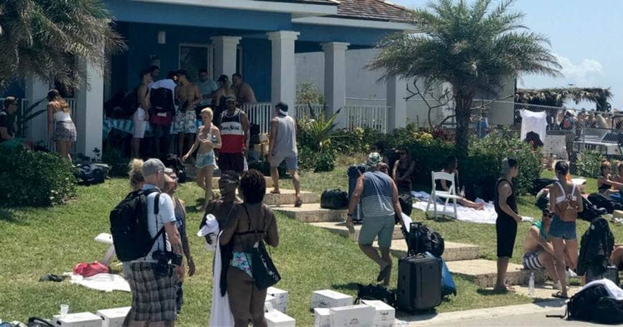 Many Fyre Festival attendees at a cottage