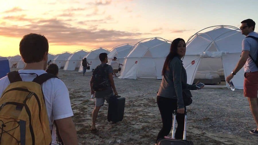 People arriving on the beach at the Fyre Festival
