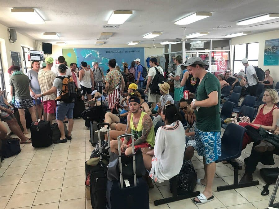 festival-goers at the airport