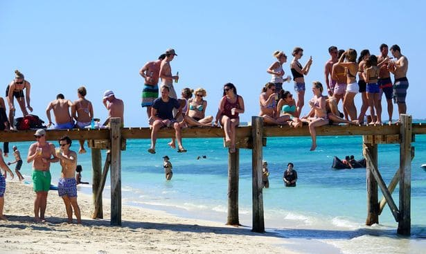 festival-goers stranded at the beach