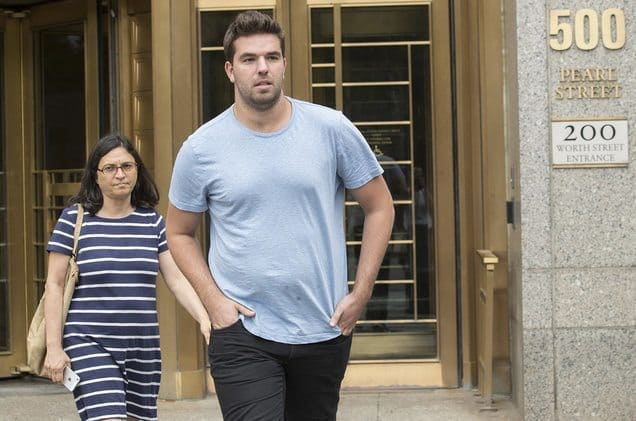 Billy McFarland walking out of court