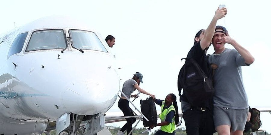 People getting off a plane