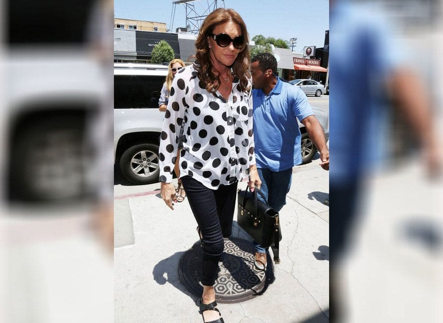 Caitlyn Jenner in a black and white dotted blouse while filming her E! Docu-series on West Third Street.