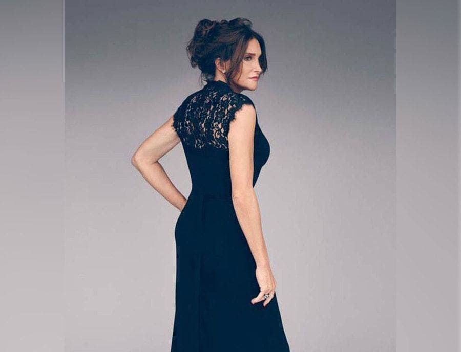 Caitlyn Jenner in a navy blue dress for a photoshoot with E!