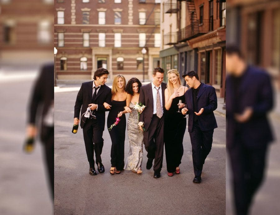 A promotional shot for season six with the whole cast, and Rachel Green is wearing a long spaghetti strapped dress.