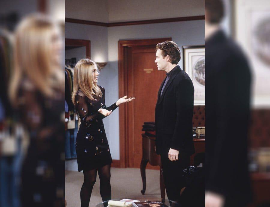 Rachel Green talking to Tate Donovan in a nice black dress.