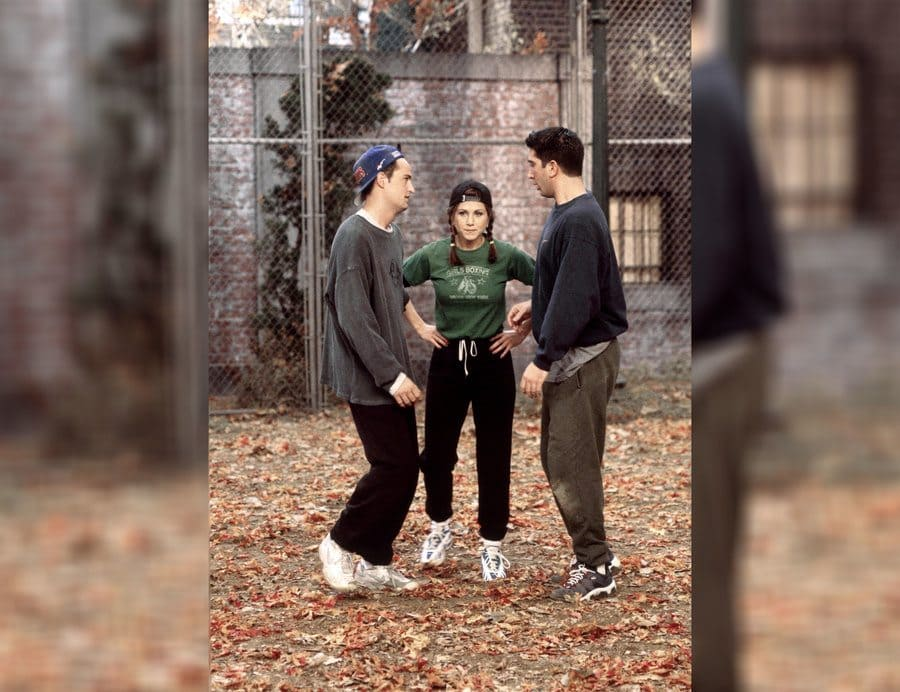 Rachel Green in the long-sleeved green shirt with black sweatpants.
