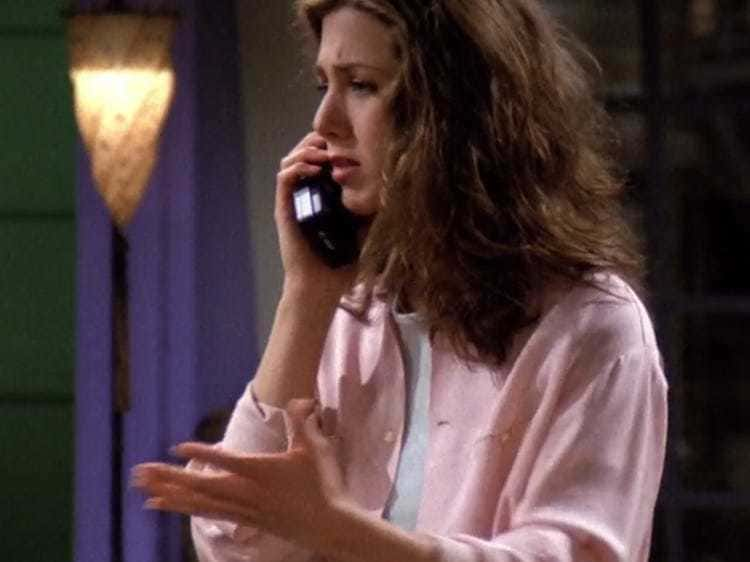 Rachel Green on the phone in her pink button-down shirt. d