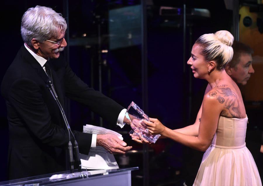 Sam Elliott and Lady Gaga on stage being honored by SAF-AFTRA.