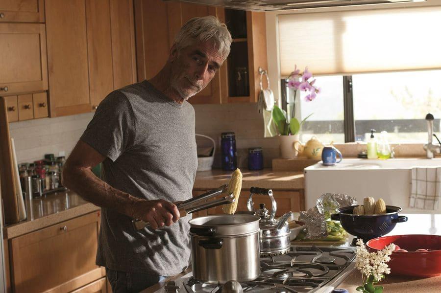 Sam Elliott in the movie 'Grandma' cooking corn on the cob in the kitchen.