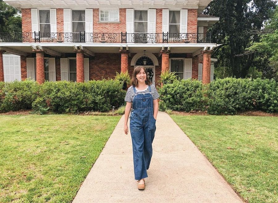 Someone standing in front of the famous house from Steel Magnolias.