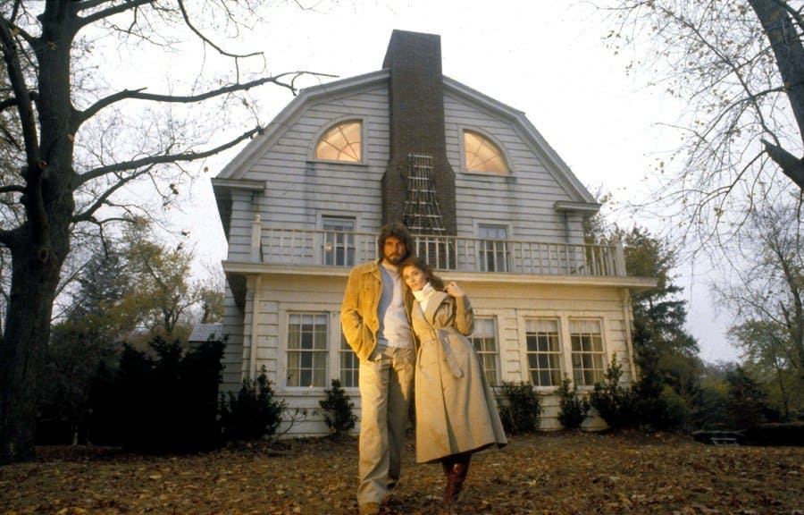 James Brolin and Margot Kidder in front of the house in the movie Amityville.