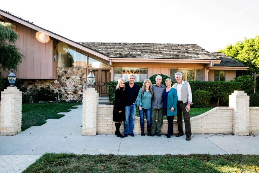 Members of the Brady Bunch cast pose in front of the original Brady home in Studio City.