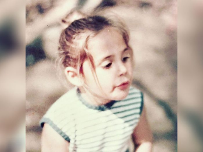 Ricki Lake in a striped no-sleeve shirt as a child.