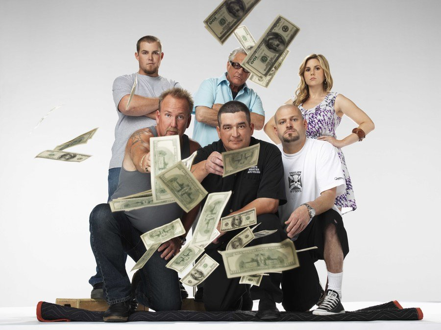 Brandon Sheets, Darrell Sheets, Barry Weiss, Dave Hester, Jarrod Schulz, and Brandi Passante were throwing money around in a promo shot from Storage Wars.