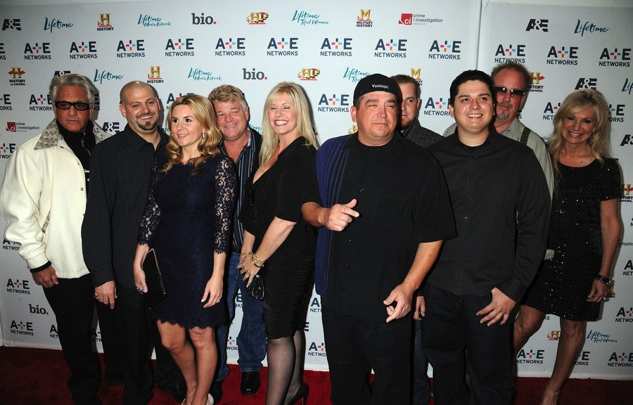 The cast members of Storage Wars in 2011 standing at a network event.