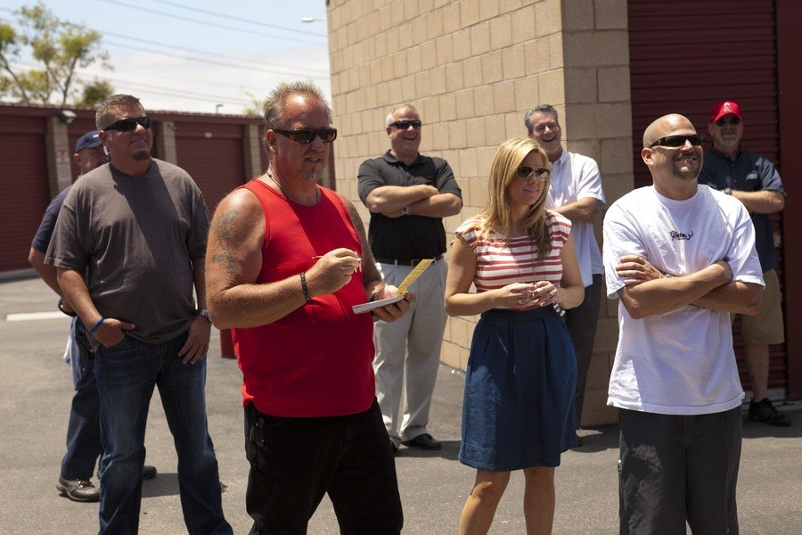 Darrell Sheets, Brandi Passante, and Jarrod Schulz were standing in a crowd on Storage Wars.
