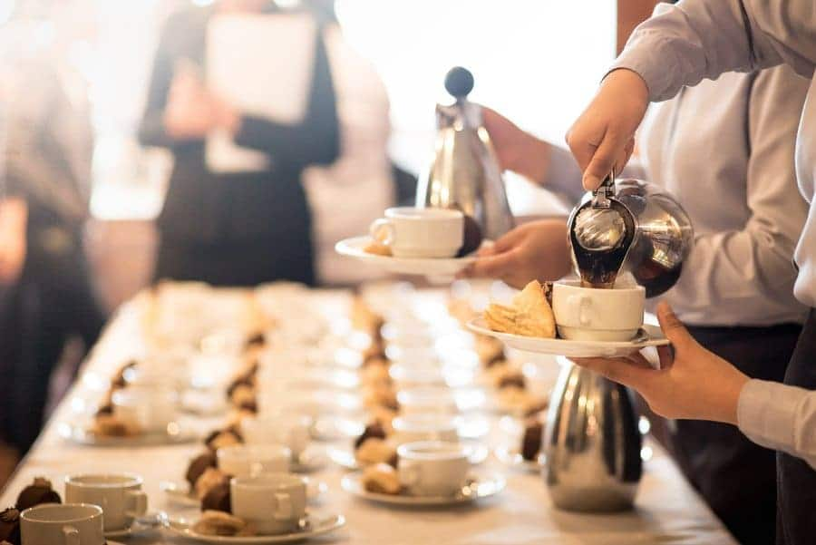 Coffee being poured for service at a hotel