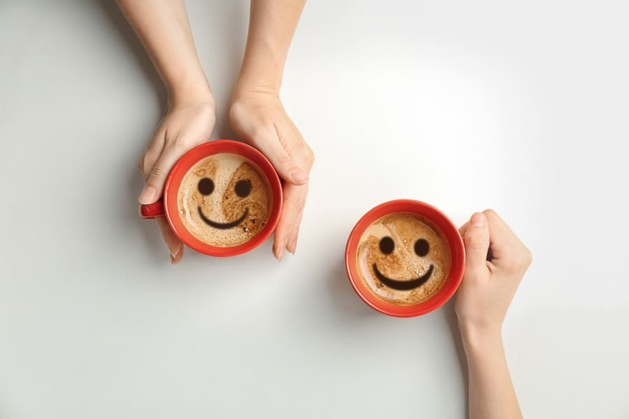 Coffee cups with a smiley face