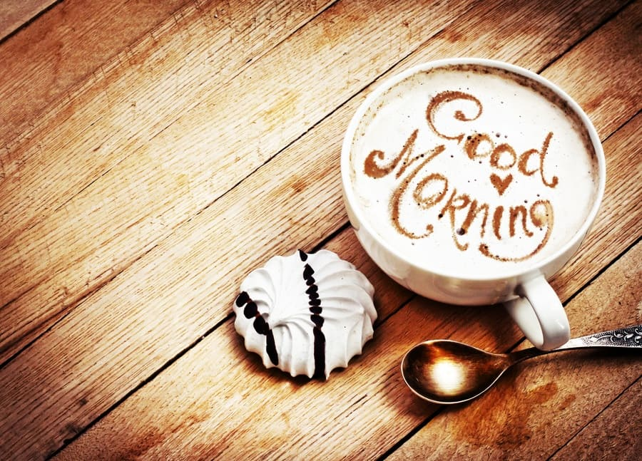 Good Morning written in a cup of coffee