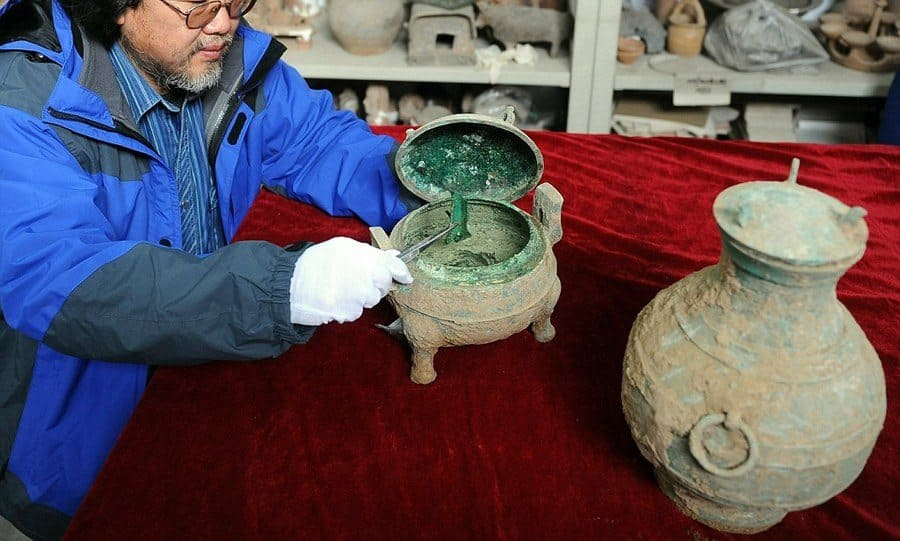 One of the archaeologists opening 2400-year-old soup.