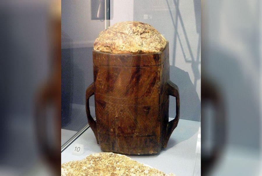 The skinny wooden barrel filed with bog butter.