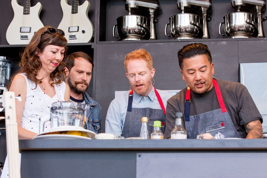 Nikki Monniger, Bryan Aubert, Jesse Tyler Ferguson, and Roy Choi at the BottleRock Napa Valley Festival on Day one, cooking together.