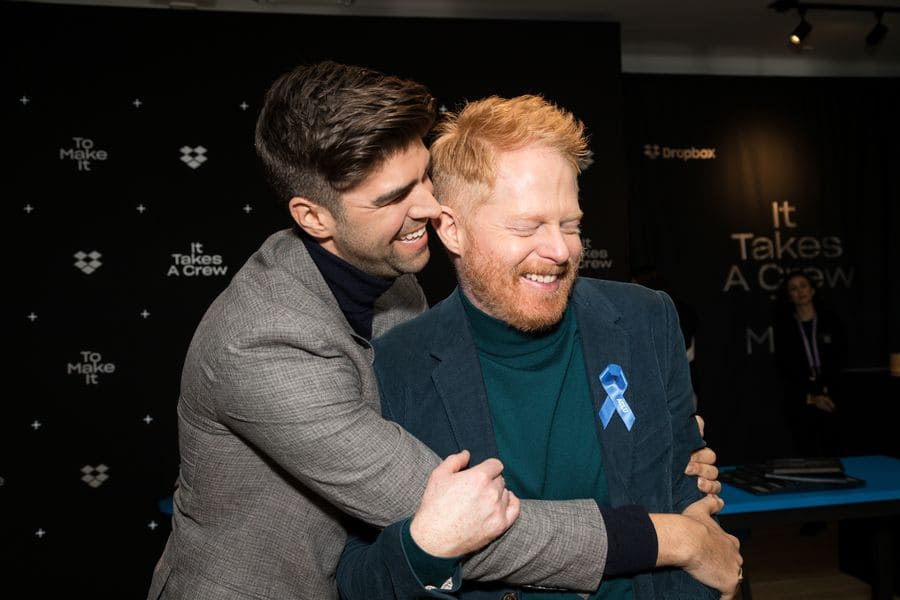 Jesse Tyler Ferguson and Justin Mikita are embracing at the IndieWire Sundance Studio Sundance Film Festival in 2020.
