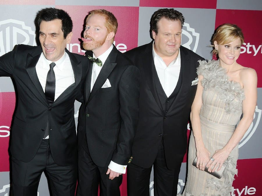 Ty Burrell, Jesse Tyler Fergusson, Julie Bowen, and Eric Stonestreet at the Golden Globe Awards after-party for Warner Bros and InStyle in 2011.