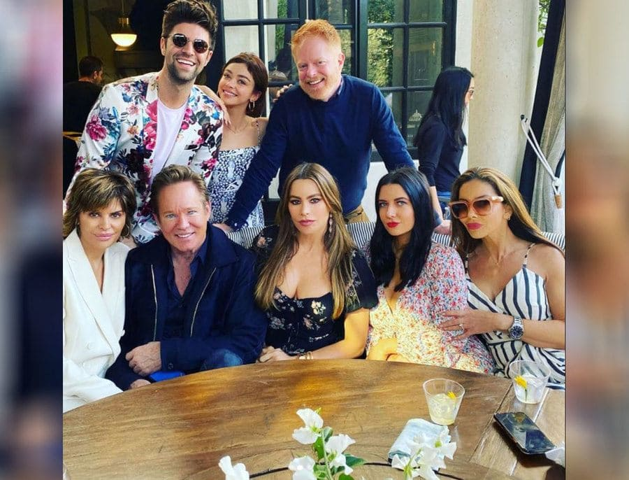 Jesse Tyler Ferguson and his husband surrounded by celebrities at their baby shower.