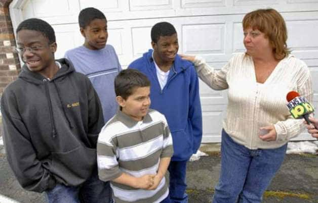 Debbie Oatman stands with her sons