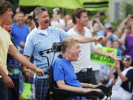 Brian Keefer, center and his family react after seeing their newly renovated home