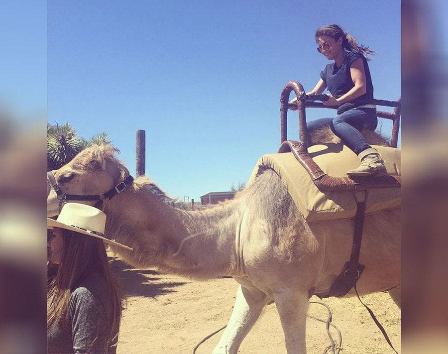 Mary Padian riding a camel